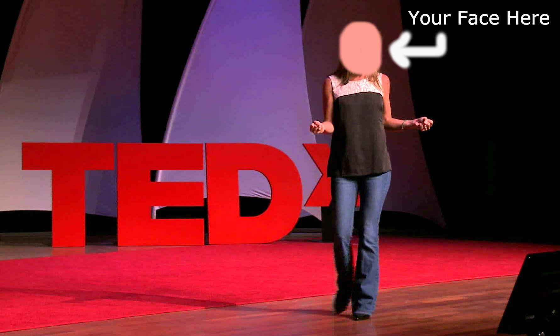 Woman standing on TED stage, face blurred